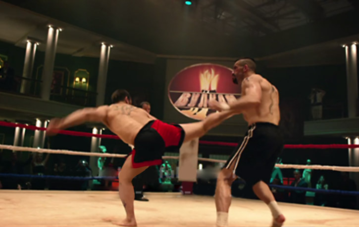 Boyka is caught off guard with a spinning back kick!