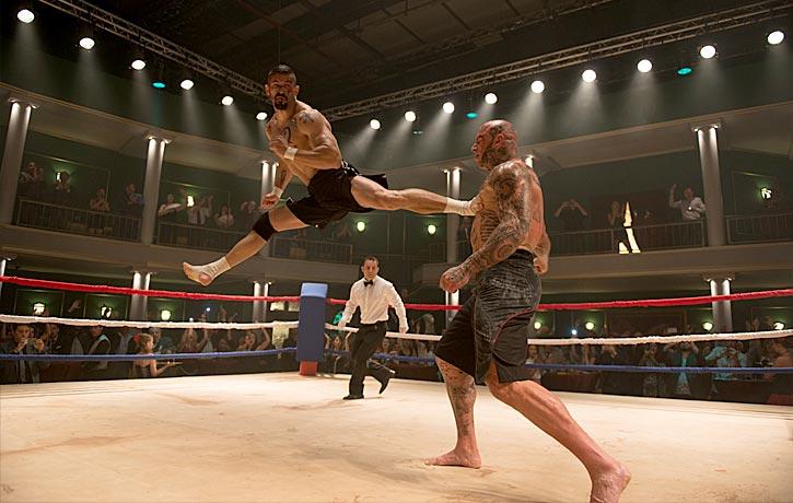 Unleashing a powerful jump- spinning back kick on Koshmar
