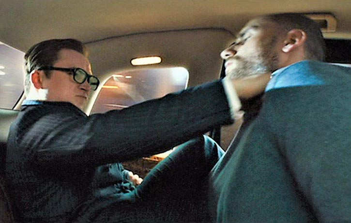 Eggsy and Charlie battle in a speeding taxi
