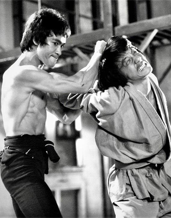 Bruce delivering the famous neck break on Jackie Chan! Credit - Photofest