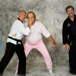 Gene on the cover of Black Belt magazine with martial arts legends, Bill Wallace & Chuck Norris!