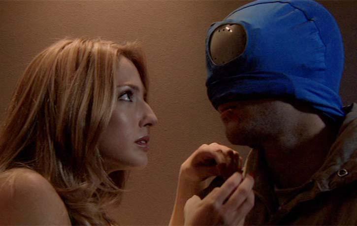 Carol about to unmask Mirageman...