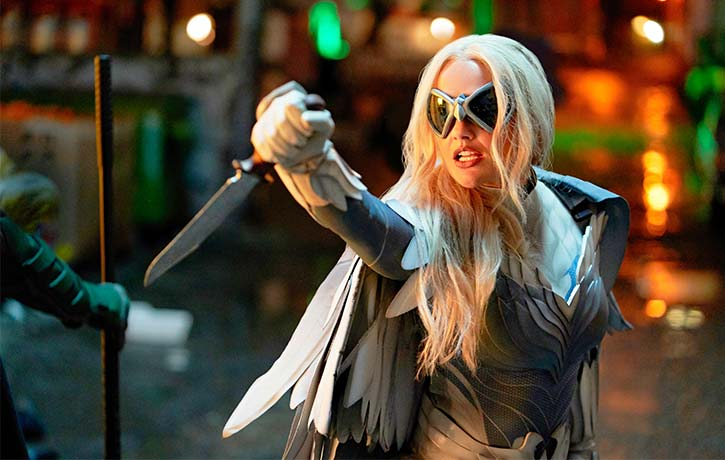 By night, Dawn Granger fights crime as the formidable Dove!