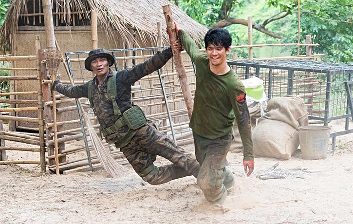 Iko Uwais gives Tony a hand during the explosive opening of Triple Threat!