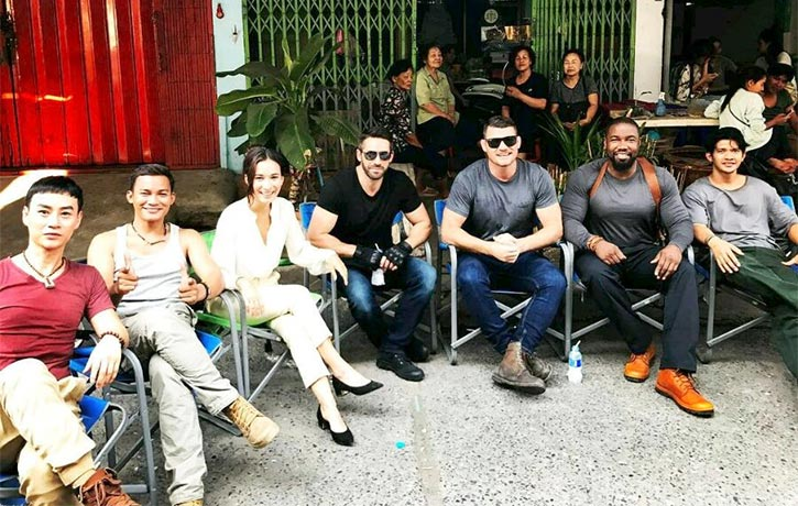 Tiger chills with his co-stars on the set of Triple Threat