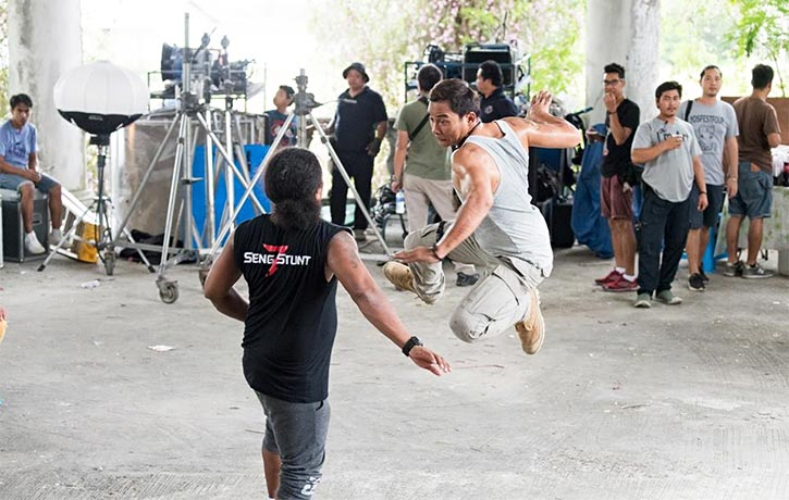 Tony traces through an action sequence on the set of Triple Threat