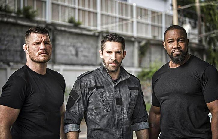 Mike forms a villainous Triple Threat with Scott Adkins and Michael Bisping