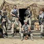 Maxx in a battlefield pic with fellow mercenaries