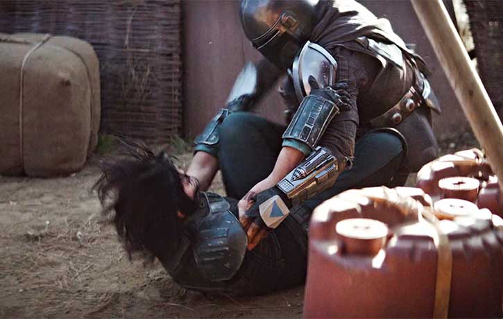 Gina Carano setting up for a sacrifice throw