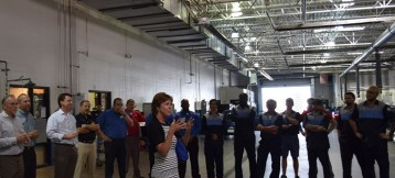 Mindy introduces Holman to service techs