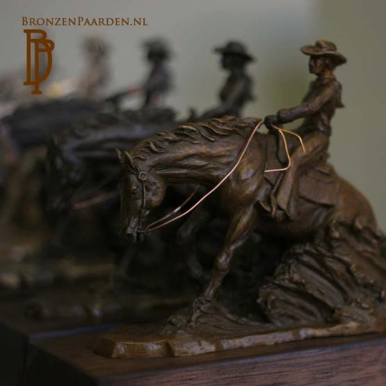 sliding stop beeldje brons