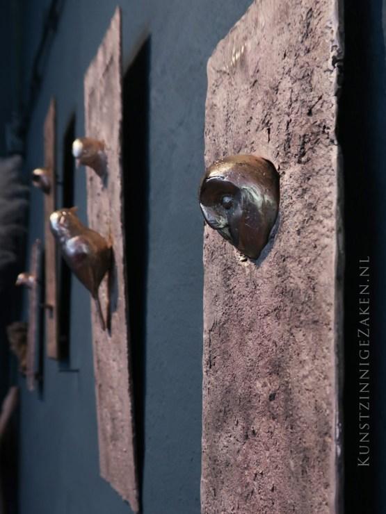 Kerkuil werk aan de muur
