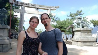 We in front of a gate in Miyajima