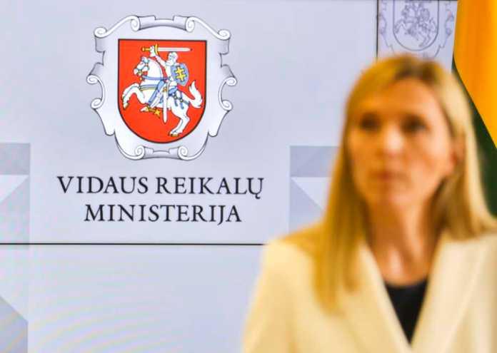 Ministerstwo Spraw Wewnętrznych Litwy, minister spraw wewnętrznych Litwy oraz logotyp resortu,.