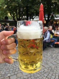 Downing a beer in a beer garden in Munich, Germany.