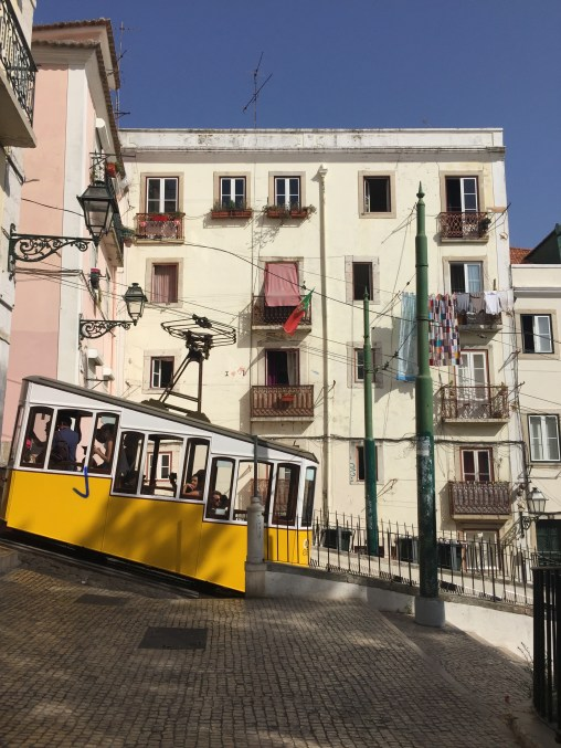 Tram climbing a hill in Lisboa, Portugal.