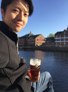 Downing an ale by the River Ouse in York, England.