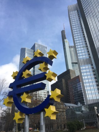 The Euro Sign at the Eurotower, Seat of the European Central Bank in Frankfurt, Germany.