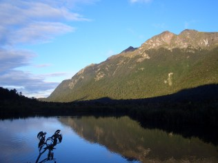 Adoring the beautiful Mirror Lake on the way to Milford Sound, in the Fiordland National Park, New Zealand.