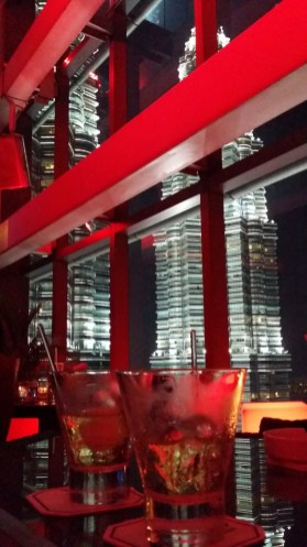 Having a drink in Marini's on 57 with a view of the Petronas Towers in Kuala Lumpur, Malaysia.