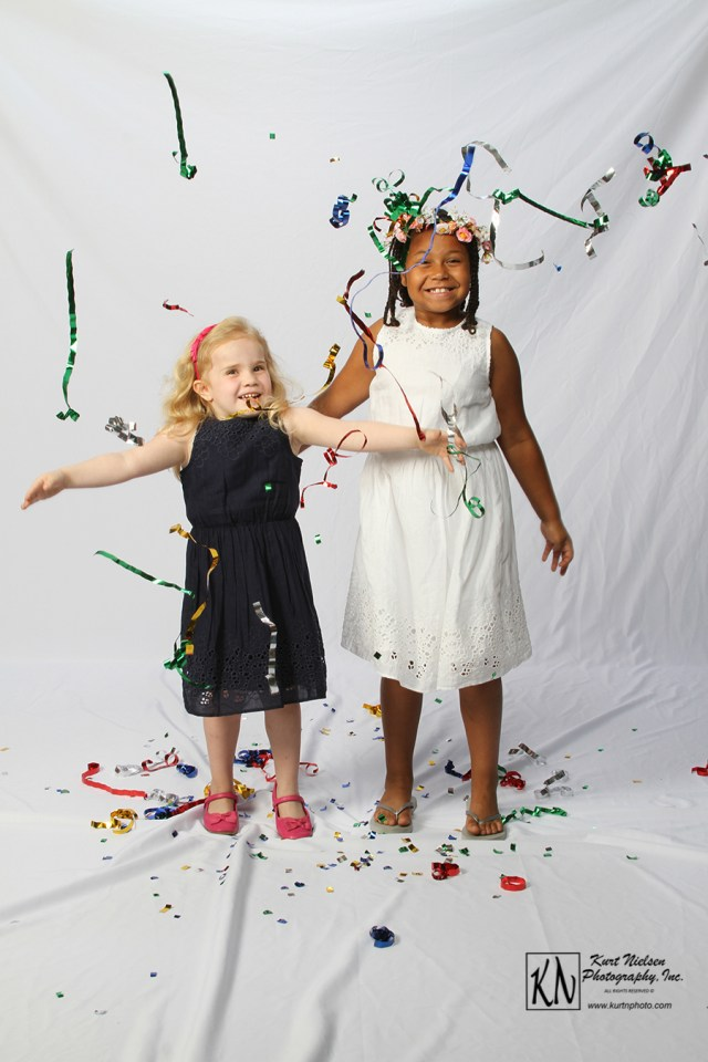 fun with confetti by Toledo child Photographer Kurt Nielsen