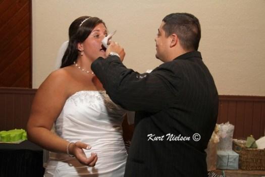Smearing wedding cake on face
