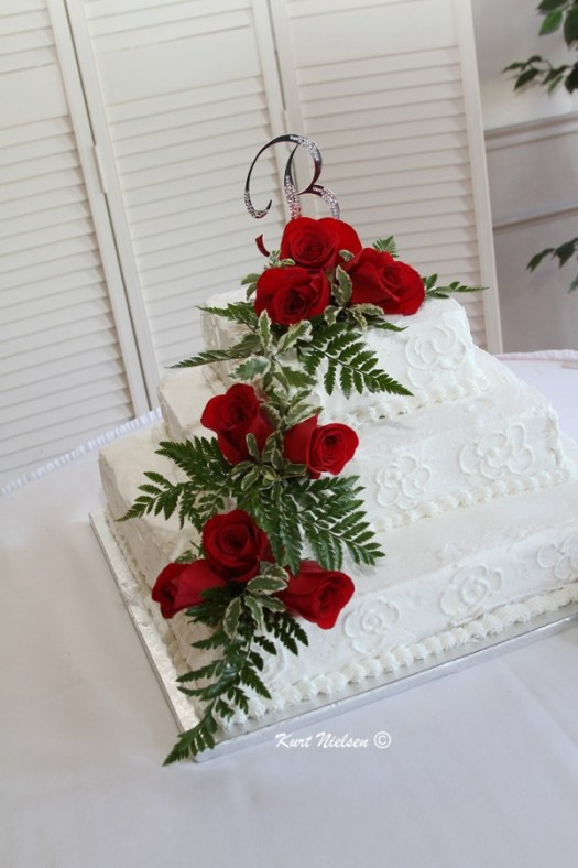 3 tier wedding cake with real flowers