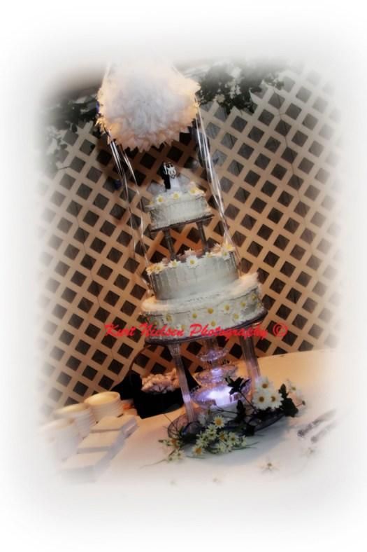 white wedding cake with daisies