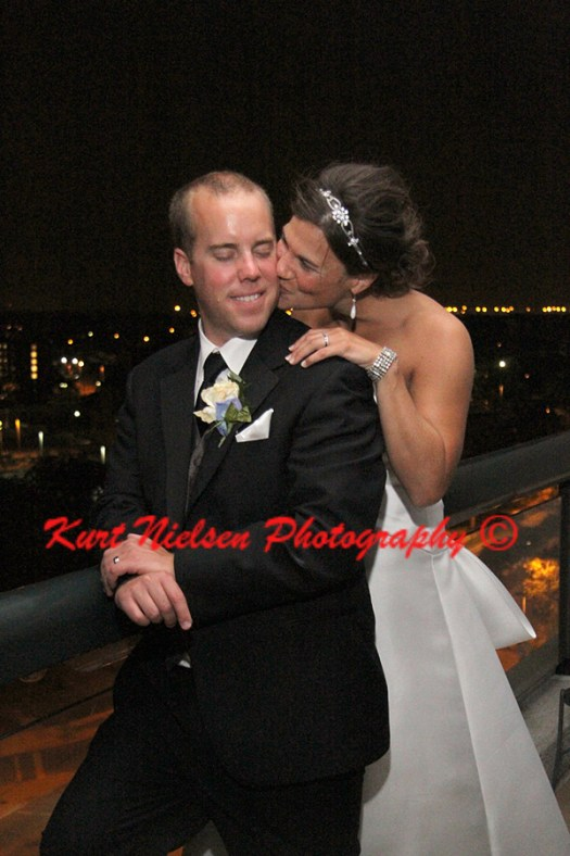 wedding photos on the balcony of the Grand Plaza Hotel