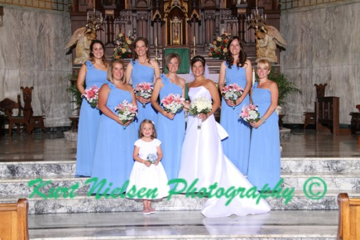 bride and bridesmaids in the church