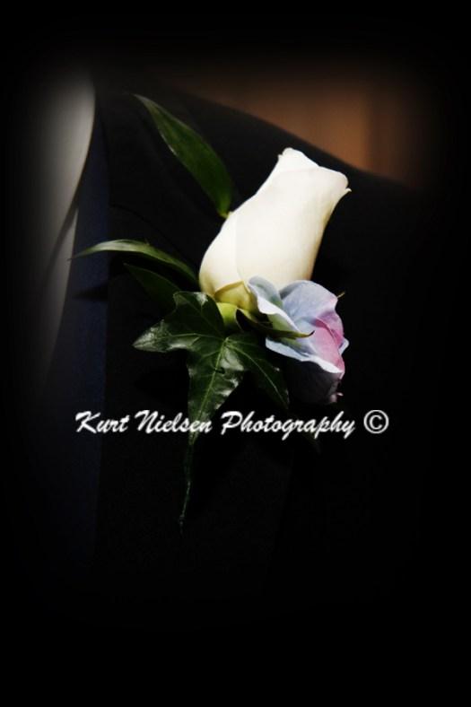 white rosebud boutonniere