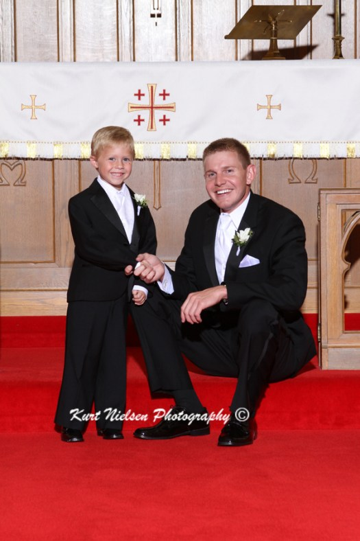 ring bearer and groom photos