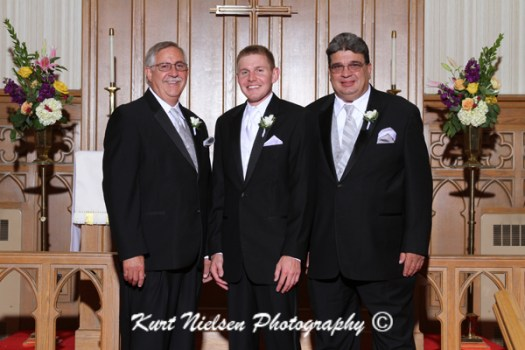 groom with the fathers photos