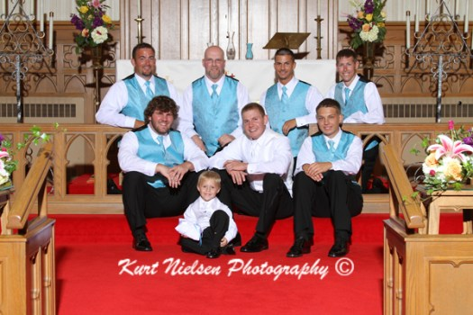 church formal photo of groomsmen