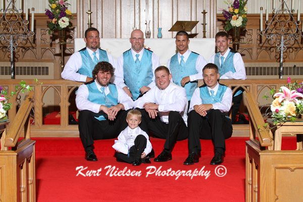 church formal photo of groomsmen