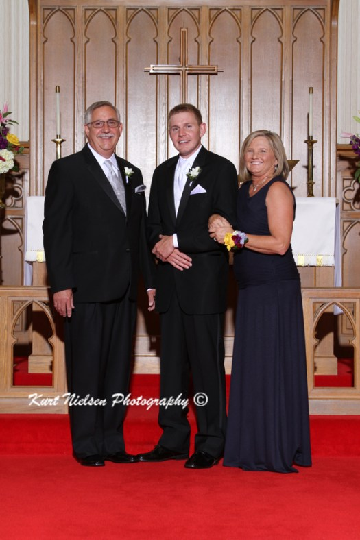 groom with his parents photo