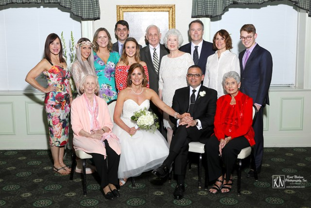 the bride and groom with the bride's family