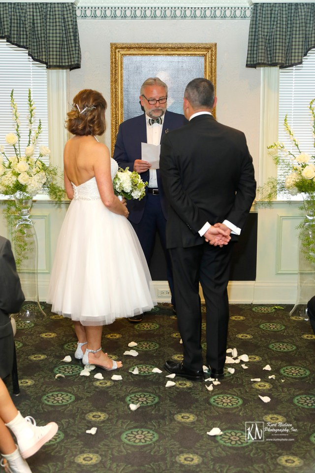 wedding ceremony in the Corinthian Room at the Toledo Club