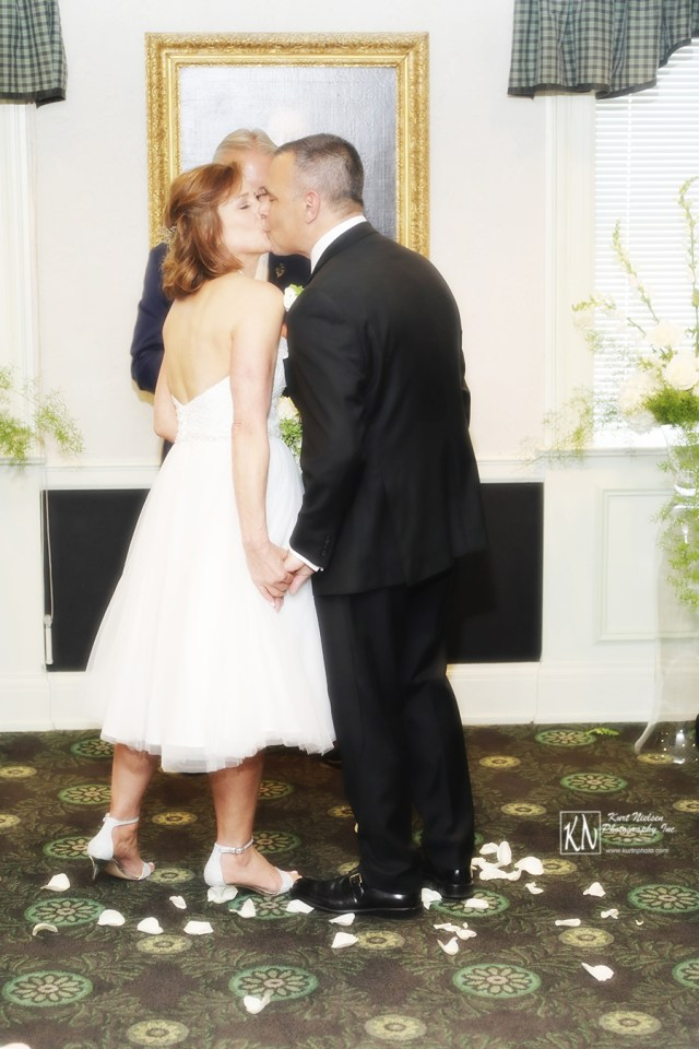 the wedding kiss at the altar