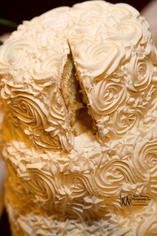 white frosting roses wedding cake