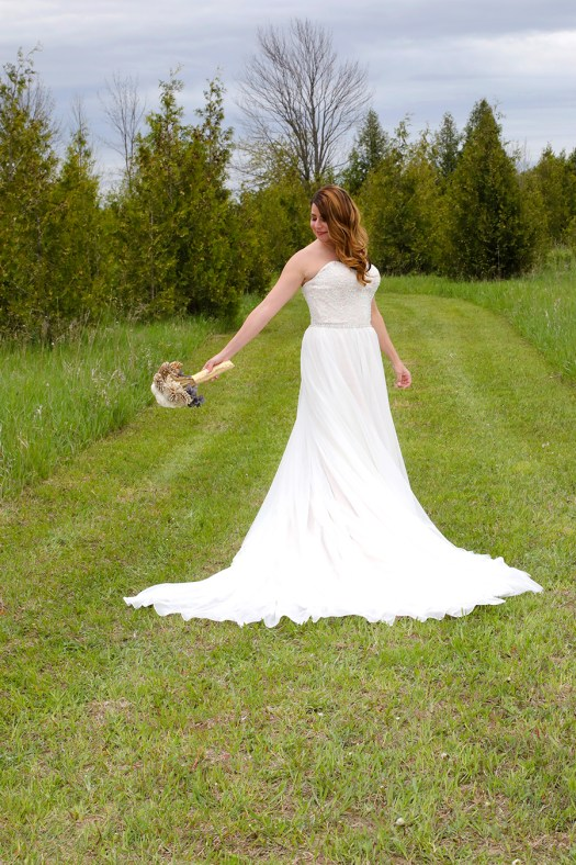 picture of the bride in her gown from Atlas Bridal Shop