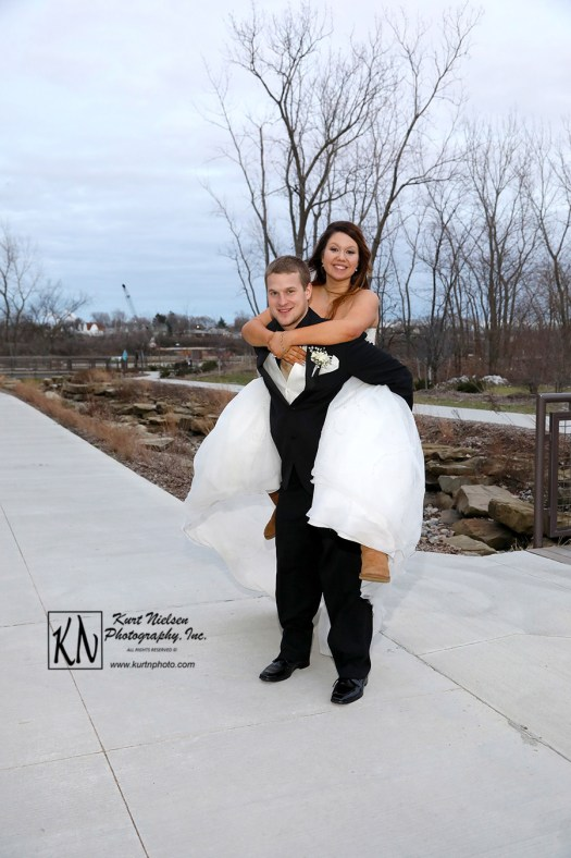 piggy back ride for bride