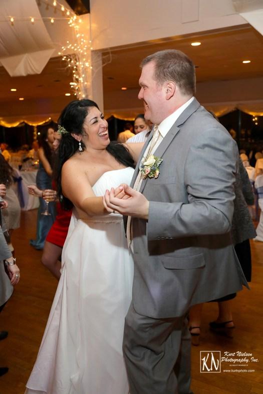 happy bride and groom dancing the night away