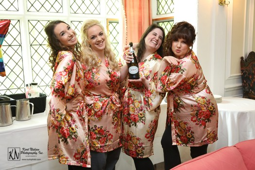 the bride and her bridesmaids toasting with bride drinking barefoot wine bubbly prosecco