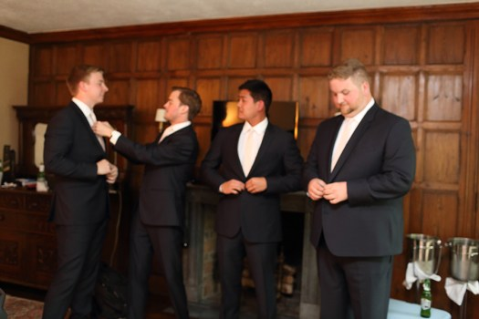 the groom and groomsmen getting ready before the wedding at the Club at Hillbrook in Chagrin Falls Ohio