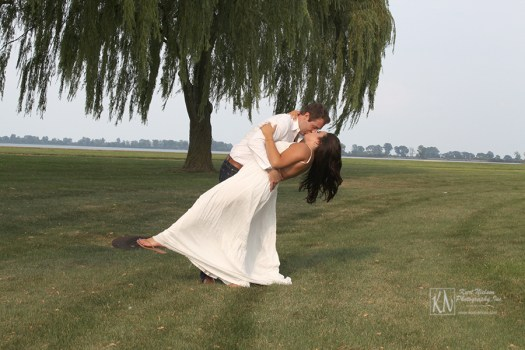 engagement portraits taken underneath the weeping willow tree
