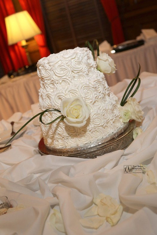 three layer white wedding cake with rosette frosting
