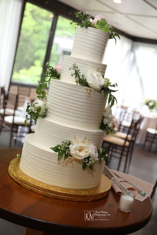 flowers from Molly Taylor and Co and gold leaf flakes on wedding cake from Luna Bakery and Cafe
