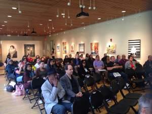 Crowd watching Dr. Gilda Del Risco recite her poem