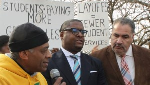 Rev. Ronald Slaughter, center, stands with speakers from the People's Organization for Progress, left, and the NAACP, right, at a protest on Dec. 11, 2015 at Kean. (Credit: Rebecca Panico)